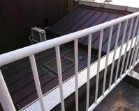 東京都豊島区商業ビルの屋上手摺鉄部錆止め塗装工事の施工事例